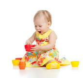 Funny child playing with toys Stock Photos