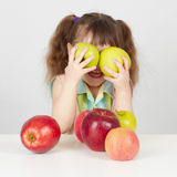 Funny child playing with two apples Stock Photography