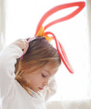 Funny child in rabbit ears Stock Photo