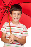 Funny child with a red umbrella Royalty Free Stock Image