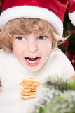 Funny child in Santa`s hat Royalty Free Stock Photography