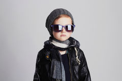 Funny child in scarf and hat.fashionable little boy in sunglasses Stock Images