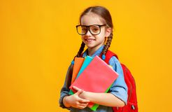 . funny child school girl girl on yellow background stock photo