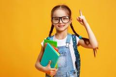 Funny child school girl girl on yellow background stock photo