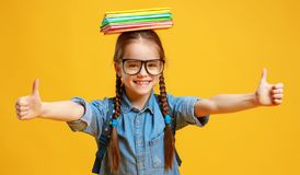 Funny child school girl girl on yellow background stock photo