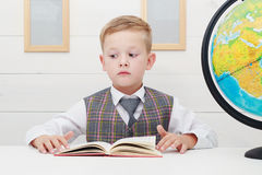 Funny Child in school.little boy with Book, Children Education Stock Photo