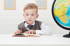 Funny Child in school.little boy with Book, Children Education Stock Image