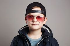Funny child in sunglasses.Fashionable boy Stock Photos