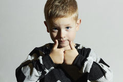 Funny child in sweater.fashion kids.children.little boy Stock Photos