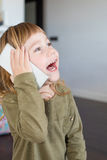 Funny child talking to mobile phone Royalty Free Stock Images