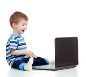 Funny child using a laptop Royalty Free Stock Image