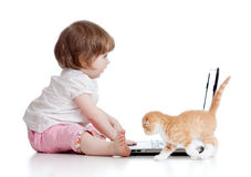 Funny child using a laptop with kitten Royalty Free Stock Photography