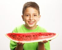 Funny child watermelon. Royalty Free Stock Images