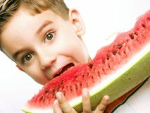 Funny child watermelon. Stock Photo