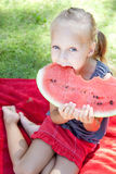 Funny child with watermelon in the park Royalty Free Stock Photography