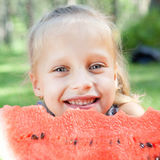 Funny child with watermelon in the park Stock Photo