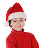 Funny child wiht Xmas hat Stock Photography