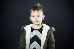 Funny child in winter coat. fashion kid.children.khaki parka.little boy with big eyes Royalty Free Stock Images