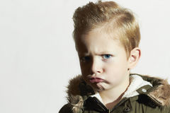 Funny child in winter coat.little boy.hairstyle Royalty Free Stock Photos