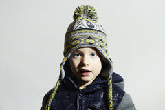 Funny child.winter fashion kids.fashionable little boy in winter color cap Royalty Free Stock Photos