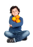 Funny Child With Many Oranges Royalty Free Stock Image