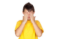 Funny child with yellow t-shirt covering eyes Stock Images