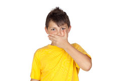 Funny child with yellow t-shirt covering the mouth Stock Image