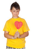 Funny child with yellow t-shirt with a lollipop Royalty Free Stock Photos