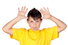 Funny child with yellow t-shirt mocking Royalty Free Stock Images