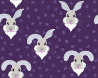Funny childish vector seamless pattern with smiling bunny faces and handwritten flowers Stock Photography