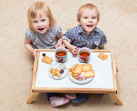 Funny Children Are Eating Dessert Royalty Free Stock Photo