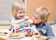 Funny Children Are Eating Dessert Royalty Free Stock Photography
