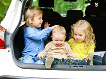 Funny children in the car Stock Image