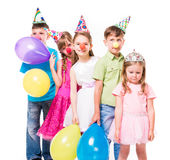 Funny children with clown noses and birthday hats Royalty Free Stock Image