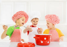 Funny children cooking Royalty Free Stock Images