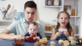 Funny children eat sweets stock image