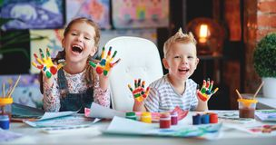 Funny Children Girl  And Boy Draws Laughing Shows Hands Dirty With Paint Royalty Free Stock Photo
