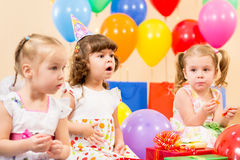 Funny children girls on birthday party royalty free stock images