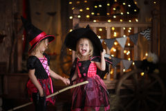 Funny children girls in witch costume for Halloween   dark backg Royalty Free Stock Image
