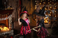 Funny children girls in witch costume for Halloween   dark backg Stock Image