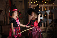 Funny children girls in witch costume for Halloween   dark backg Stock Photography