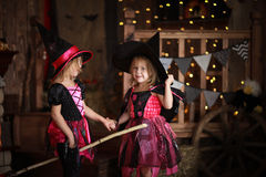 Funny children girls in witch costume for Halloween   dark backg Stock Photos