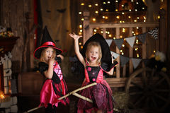 Funny children girls in witch costume for Halloween   dark backg Royalty Free Stock Photography