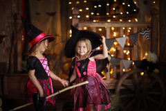 Funny children girls in witch costume play for Halloween   dark Royalty Free Stock Photo