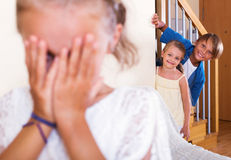 Funny children hiding from girl with Royalty Free Stock Photos