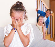 Funny children hiding from girl. With closed eyes during game Stock Photos