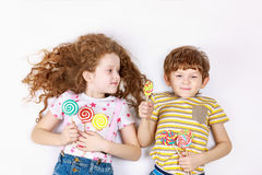 Funny children hold candy lollipop. Royalty Free Stock Photo