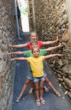 Funny children on narrow street Royalty Free Stock Photos