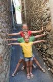 Funny children on narrow street royalty free stock photos