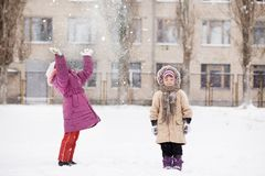 Funny children playing and laughing on snowy winter park royalty free stock photos